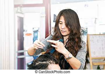 Hair stylist working - Happy hairdresser cutting hair in her...