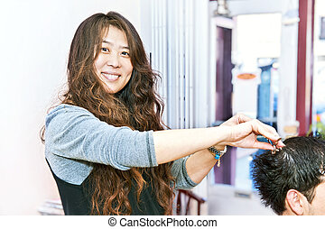 Hair stylist working - Happy hairstylist cutting hair in her...