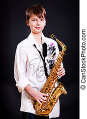 9 year old boy with a saxophone in a white shirt