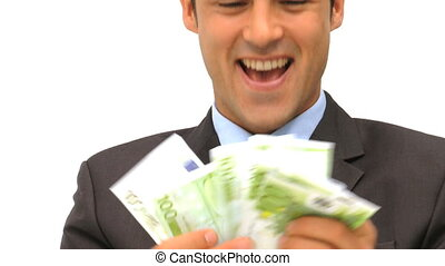Happy businessman kissing his money