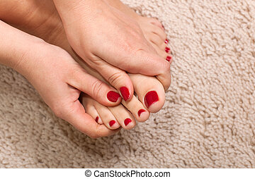 Foot massage - Close up hands massaging a foot at the white...