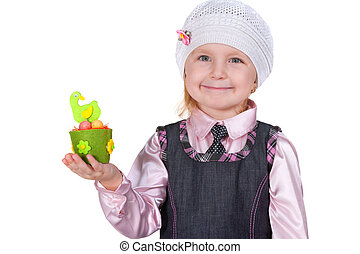 Little girl showing a toy easter hen