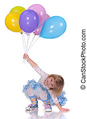 Playful girl with baloons - A cheerful laughing kid in blue...
