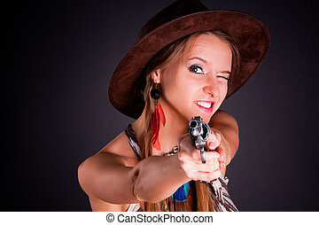 The American Indian girl in a cowboy's hat holds a pistol