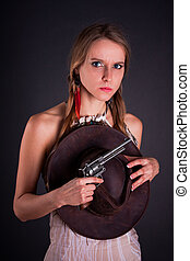 The American Indian girl with a cowboy's hat holds a pistol