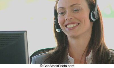 Business woman with an headset in a call center