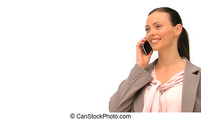Radiant woman phoning against a whi