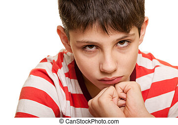 Frightened kid - A closeup portrait of a sad boy showing his...