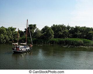 sailing boat in Danube Delta - Sailing boat in Danube Delta,...
