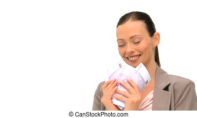 Joyful businesswoman counting her money against a white...
