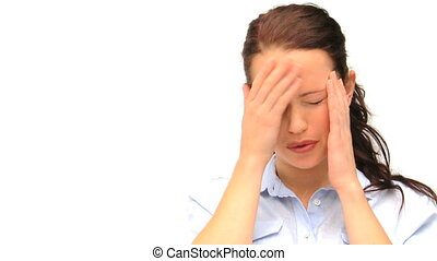 Brown-haired woman having an headache isolated on a white...