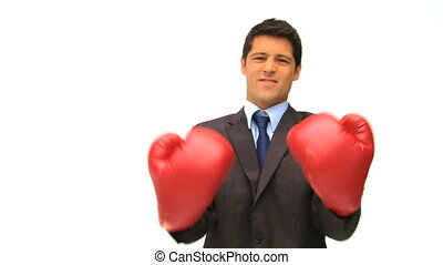 Businessman with red boxing gloves isolated on a white...
