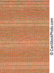 red brick wall with joints in concrete and natural materials...