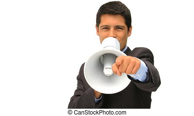 Young man shouting through a megaphone against a white...
