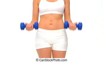 Woman doing her exercises against a white background
