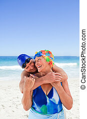 Happy elderly couple on the beach