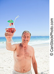 Senior man with his cocktail