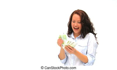Happy businesswoman counting her money against a white...