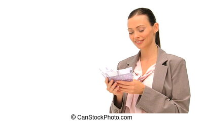 Happy businesswoman holding her cash against a white...