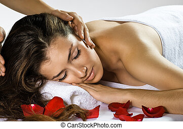 massaged - a young beautiful girl is being massaged