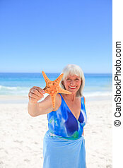 Elderly woman with her star sea