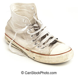 sneakers - vintage age-worn sneakers on a white background