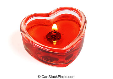 Candle in form of heart on white background