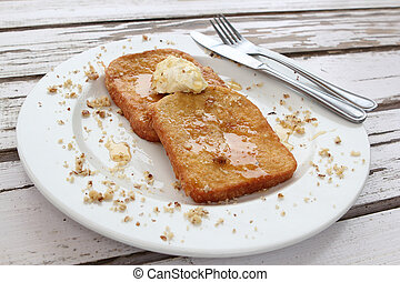 French Toast Breakfast - Two pieces of French toast with...