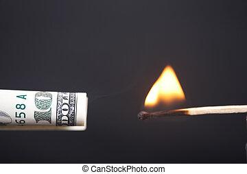 Burning dollar - The burning match sets fire to dollar