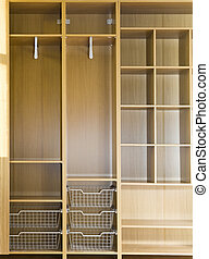 Empty wardrobe with regiments and wire baskets
