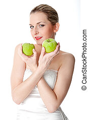 Woman with two green apples