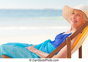 Relaxed woman at the beach