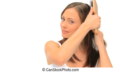 Woman fixing her hair isolated on a white background