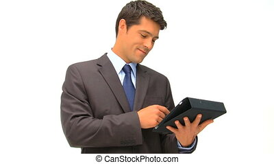 Businessman working on his graphic tablet against a white...
