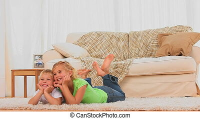Cute children watching tv in the living room