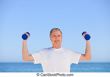 Mature man doing his exercises