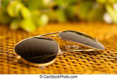 sunglasses on wicker