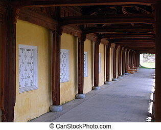 Wooden Arcade - ancient arcade with wooden colums and wooden...