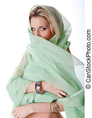 A young German woman plays with her green veil