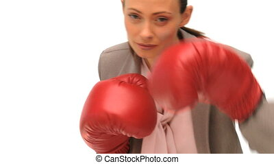 Woman with boxing gloves dressing in a formal suit