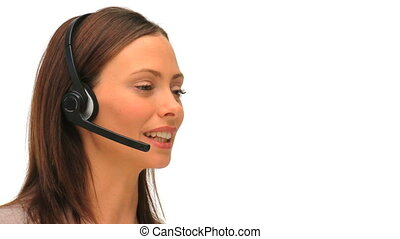 Brunette dressing in a formal suit speaking over the headset...