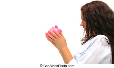 Woman kissing her piggy bank - Relaxed woman kissing her...