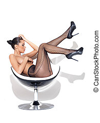 Sexy Stockings - Sexy young woman posing on chair, wearing...