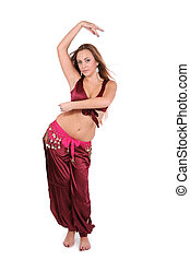 Beautiful young belly dancer in red costume