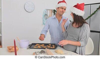 Pregnant woman baking