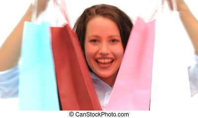 Woman after shopping against a white background