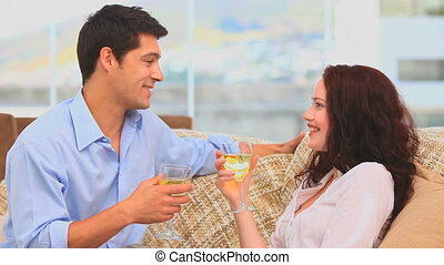 Handsome couple drinking wine