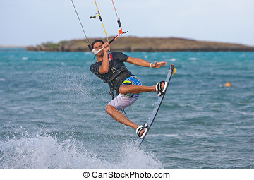 Kitesurf - Male kitesurfer kitesurfing in the lagoon of...
