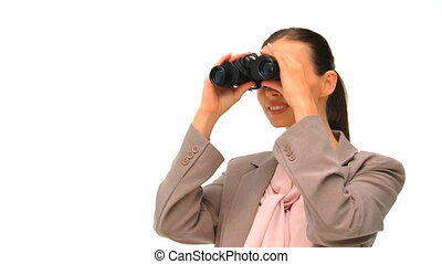 Woman looking through binoculars against a white background