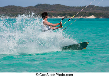 Kitesurf in the lagoon - Male kitesurfer kitesurfing in the...